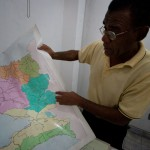 Branly Ogé, the national coordinator for the Initiative on Civil Society, identifies on a map of Haiti the locations where his observers were denied access to polling locations during the country's Nov. 28 election. (Jacob Kushner for Infosurhoy.com)