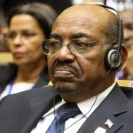 Sudan's President Omar al-Bashir attends the African Union summit in Addis Ababa, Ethiopia, Sunday, July 15, 2012. Back in Khartoum, a rapidly deteriorating economy is leading to increasing calls for his ouster (AP Photo/Elias Asmare via Columbia University Library)